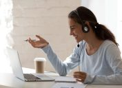 Young woman studying at laptop