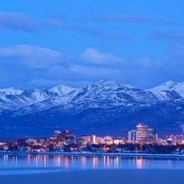 skyline photo with the Chugach mountains in Anchorage, Alaska at dusk