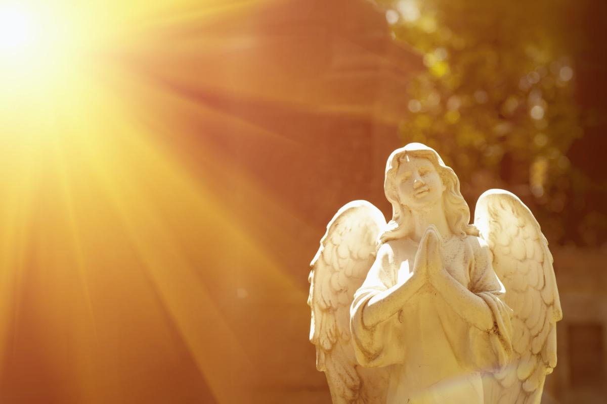 angel statue outdoors in sunlight