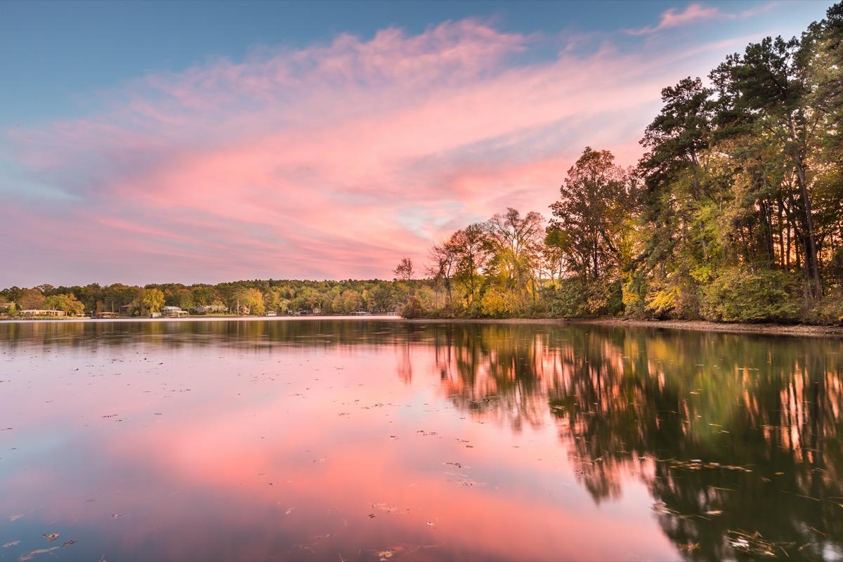 green trees and Hamilton Lake at sunset in Garland County, Arkansas