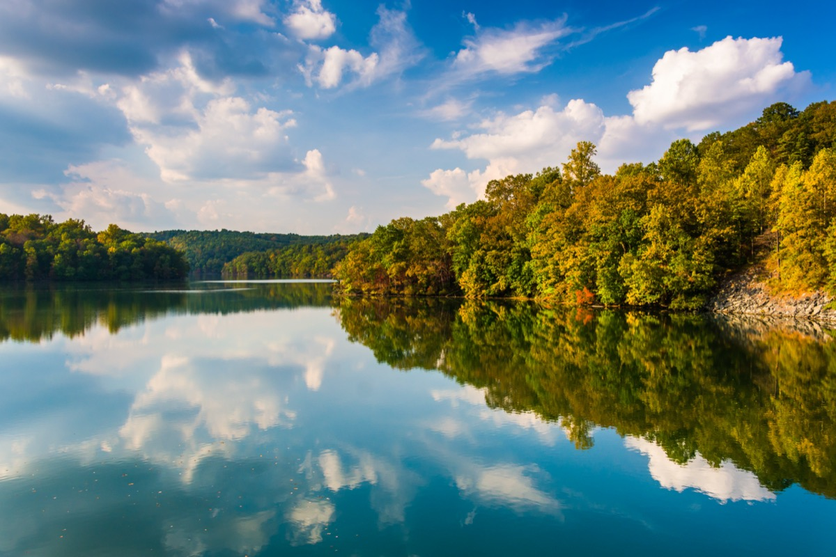 clouds and trees reflecting in the Prettyboy Reservoir in Baltimore County, Maryland