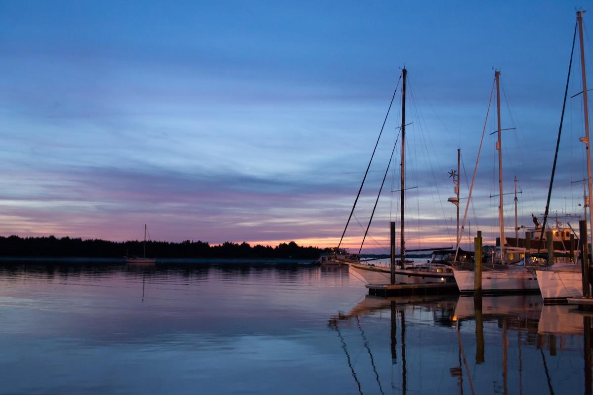 sailboat and trees along a lake in Beaufort, North Carolina