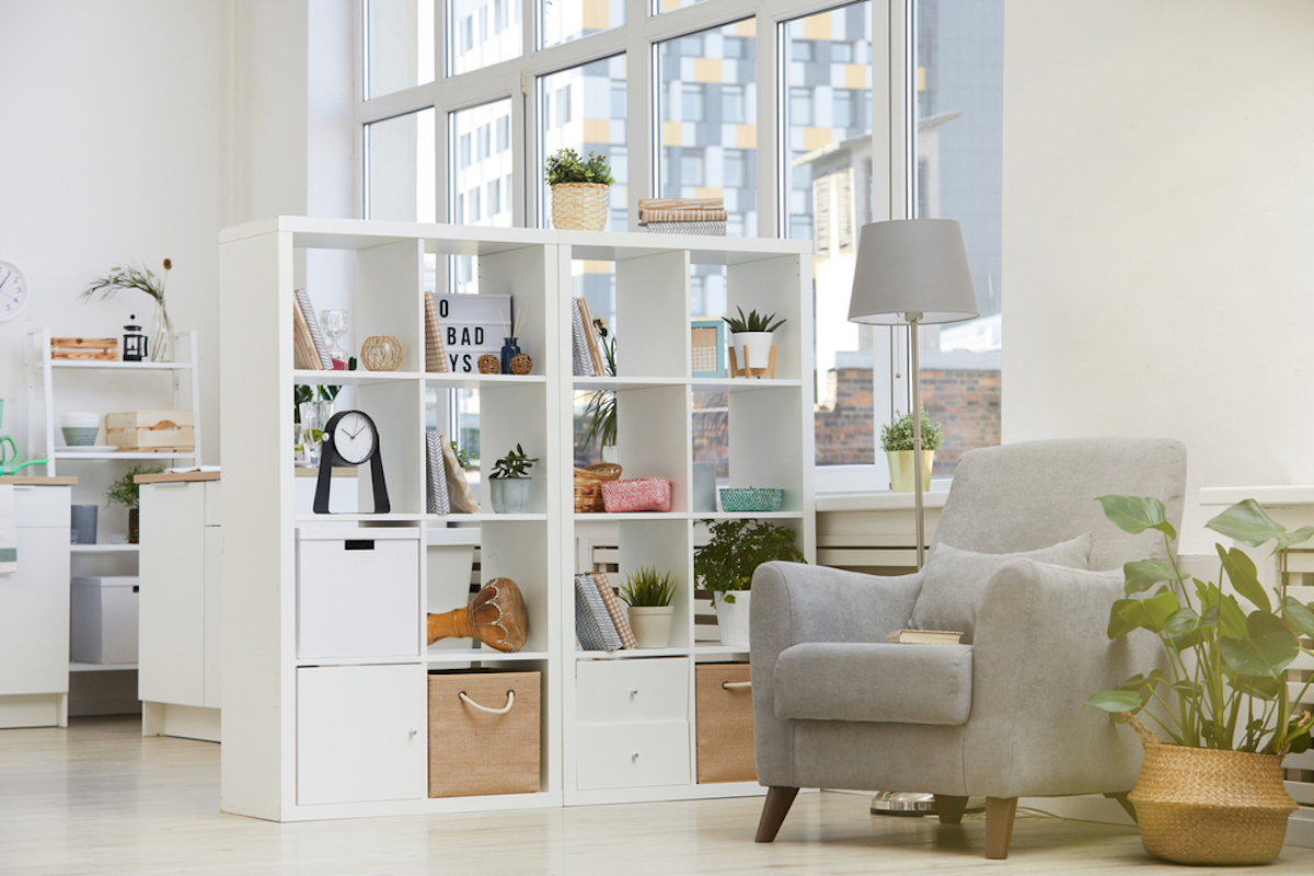 white open bookcase in living room of apartment