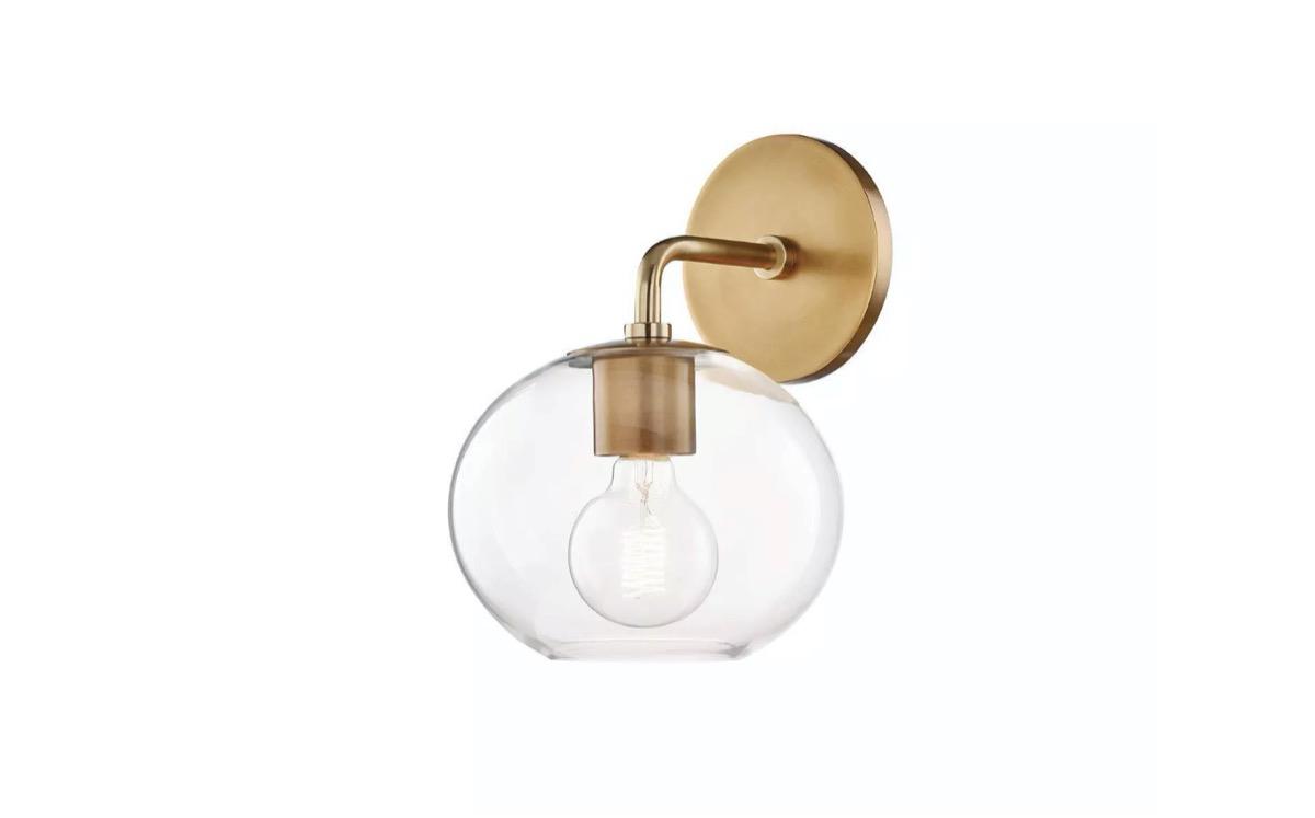 brass sconce light with glass globe