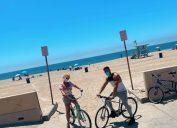 britney spears and sam asghari riding bikes at the beach