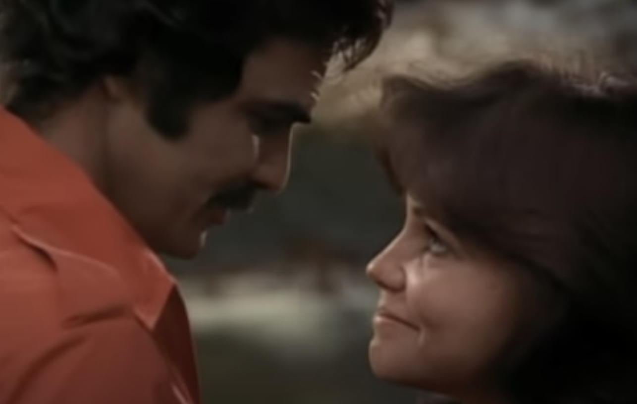 """Burt Reynolds and Sally Field about to kiss in """"Smokey and the Bandit"""" in 1977"""