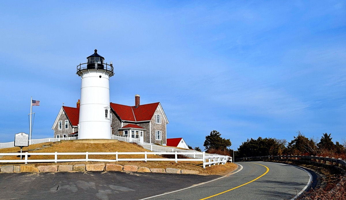 lighthouse, townhouse, and empty road in Cape Cod, Massachusetts