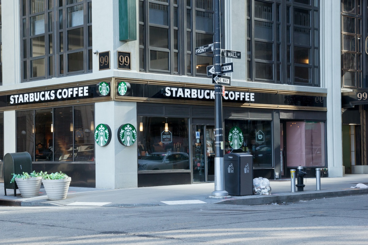 A Starbucks on the corner of Front Street and Wall Street in Manhattan's Financial District; New York City; Photo taken on April 6, 2014; editorial use only (A Starbucks on the corner of Front Street and Wall Street in Manhattan's Financial District;