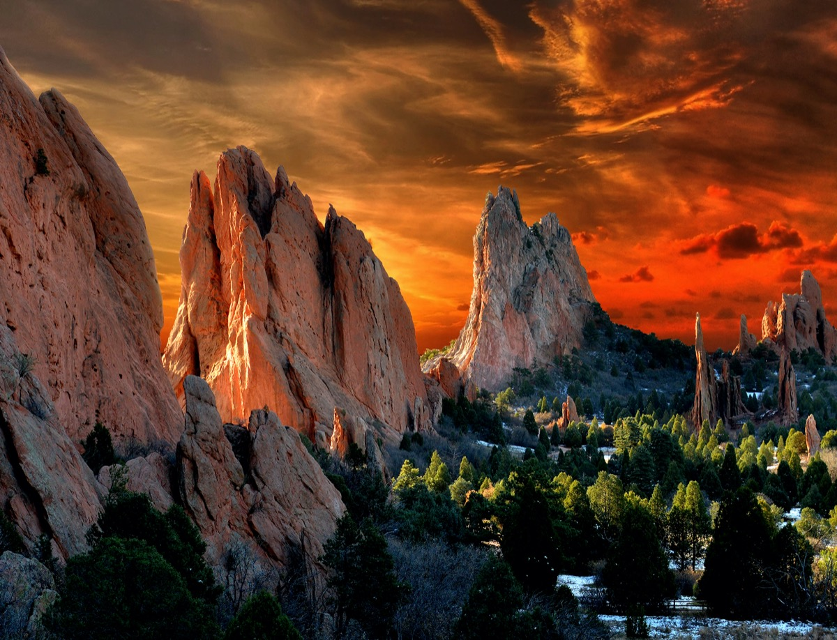 tall beige rocks and green trees at the Garden of the Gods in Colorado Springs, Colorado