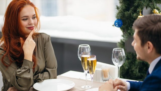 Woman looking at man mischievously while on a date