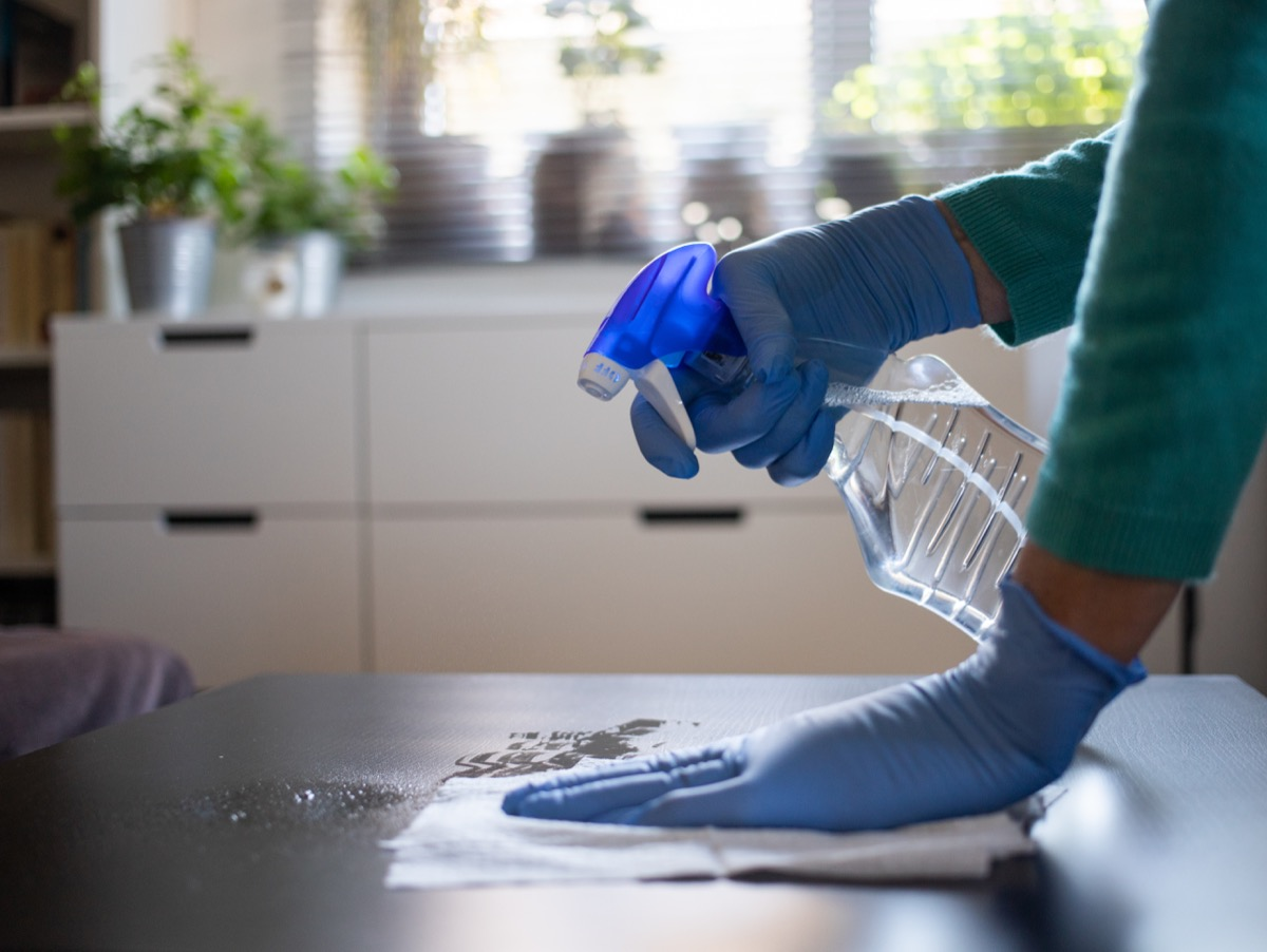 Disinfecting surface with spray