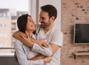 Couple sharing an embrace at home together