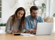 Couple stressed while working on their finances