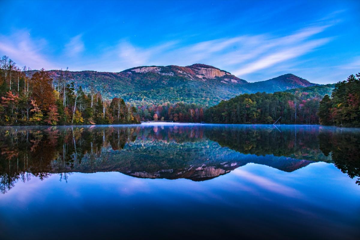 mountains and trees along Pinnacle Lake in Greenville, South Carolina at sunet