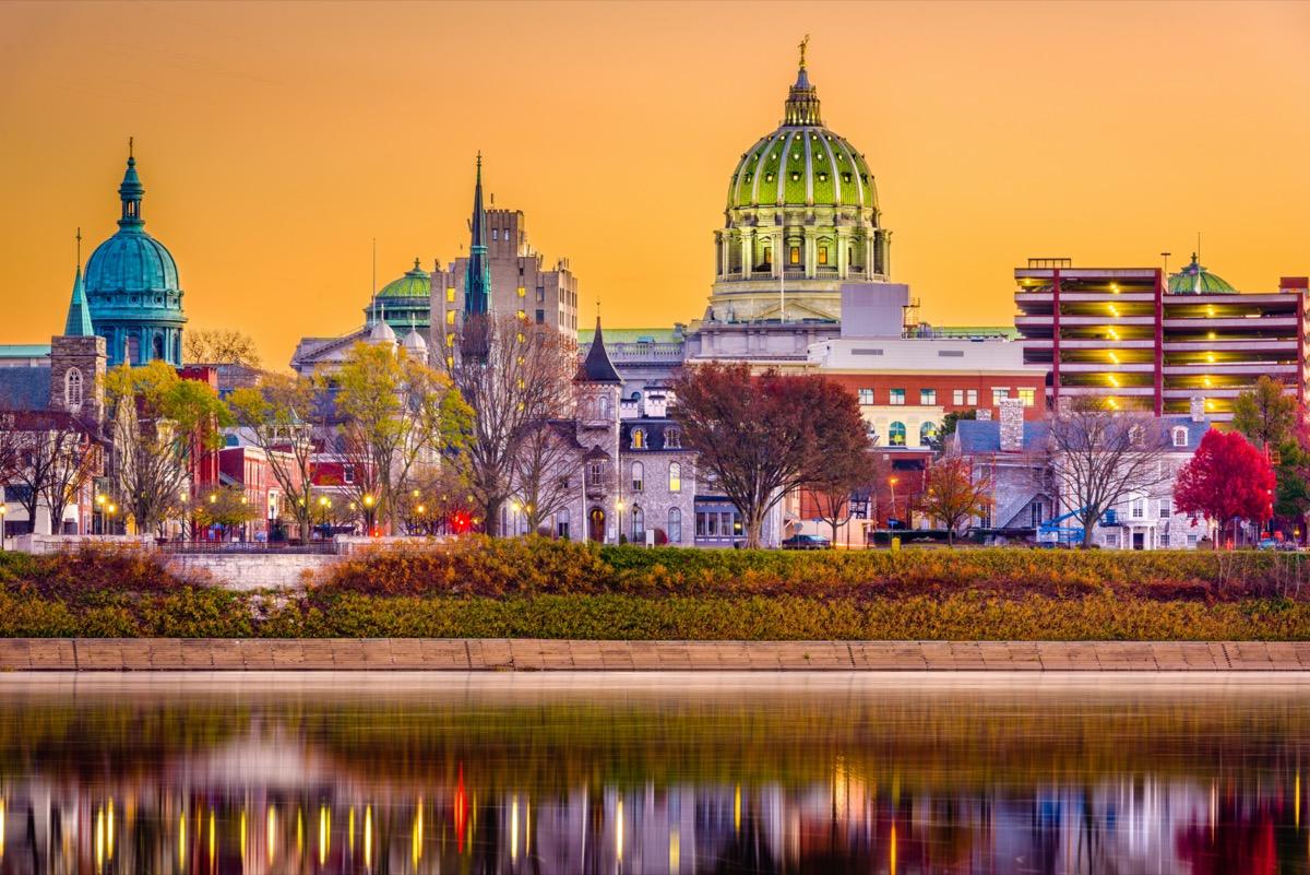 city skyline on the Susquehanna River in Harrisburg, Pennsylvania at dusk
