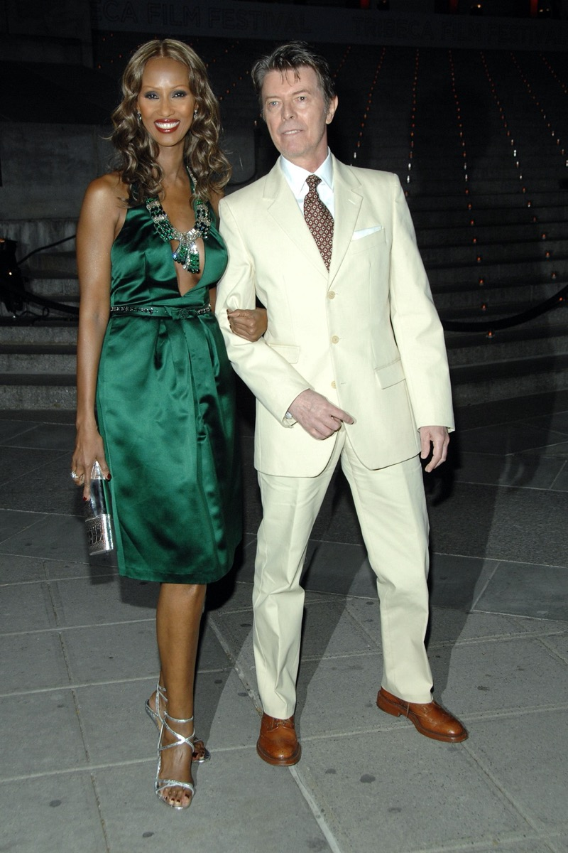 Iman wears a green dress and David Bowie wears an off white suit to the Tribeca Film Festival in 2007