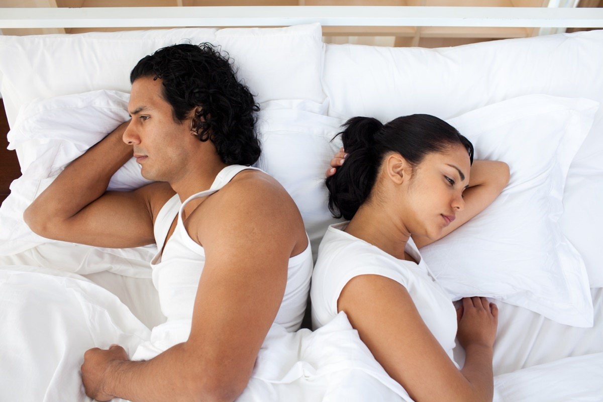 Couple in bed not having sex not talking