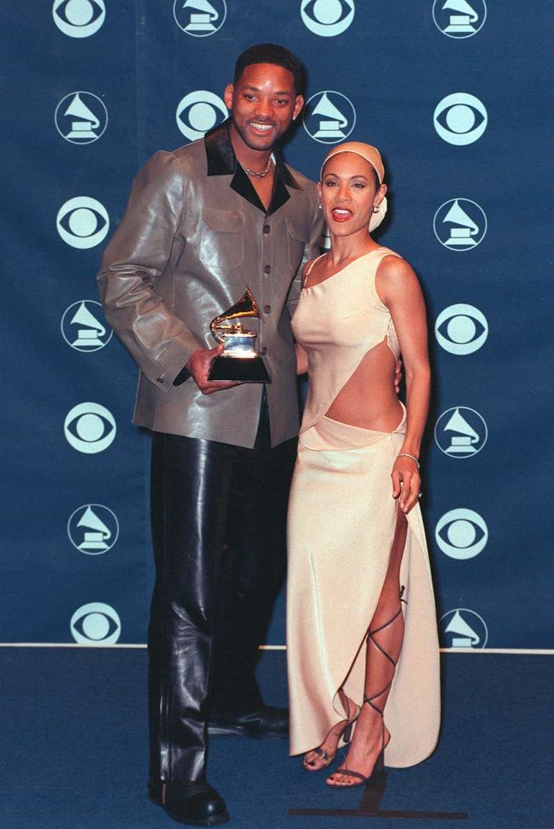 Jada Pinkett Smith wears at beige dress and Will Smith wears a grey jacket at The Grammy Awards in 1999