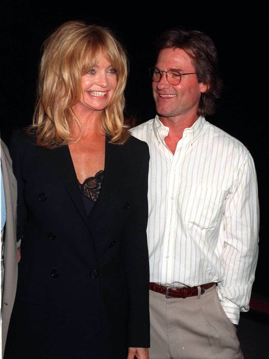 Goldie Hawns wears a black suit and Kurt Russell wears a white shirt at the premiere of 'Hope' in 1997