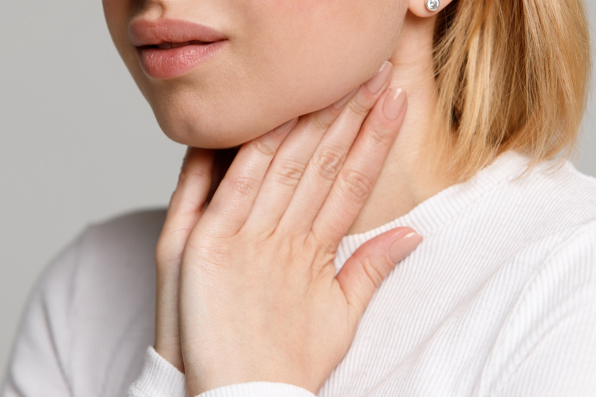 Woman checking out her swollen lymph nodes