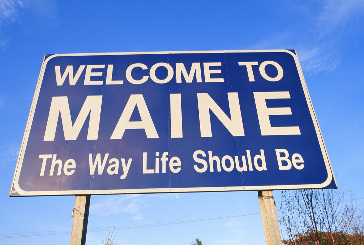 """a blue """"Welcome to Maine The Way Life Should Be"""" sign"""