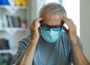 Worried mature man having a headache