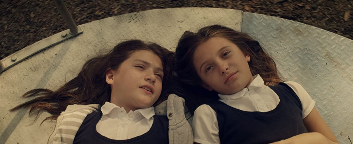 two young girls lying down in martys movie still