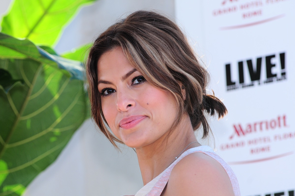 """Eva Mendes at a photocall for the movie """"Live!"""" in 2009"""