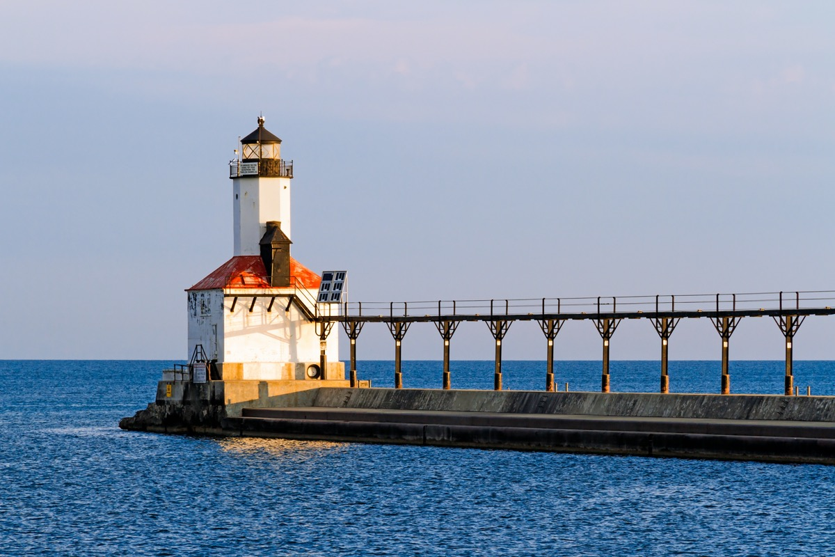 the East Pierhead Lighthouse and an elevated pier on a lake in Michigan City, Indiana