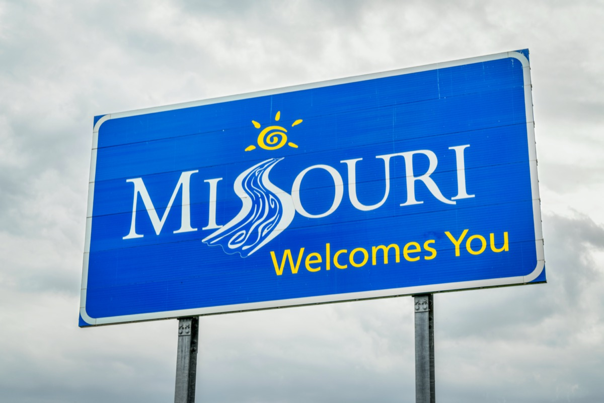 """a blue """"Missouri Welcomes You"""" sign"""