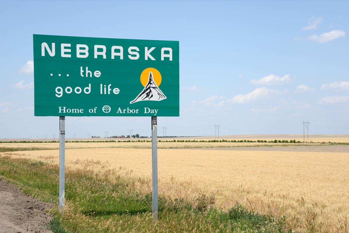 "a green ""Nebraska...the good like"" sign off of a highway"