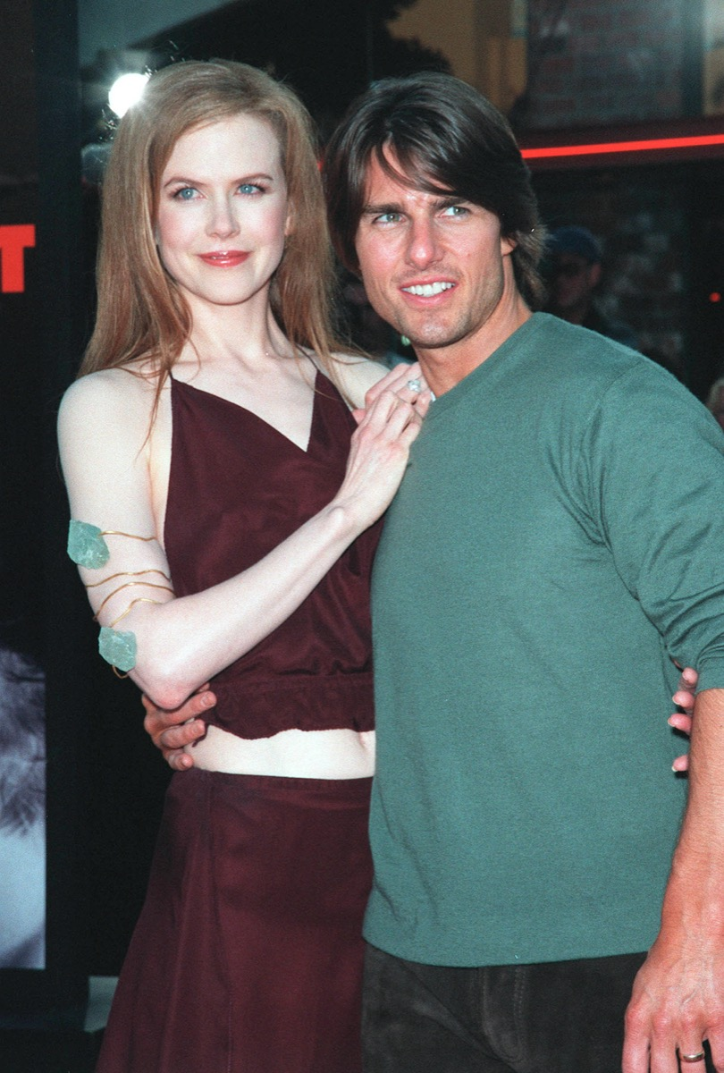 Nicole Kidman wears a maroon top and Tom Cruise wears a green sweater at the premiere of 'Eyes Wide Shut' in 1999