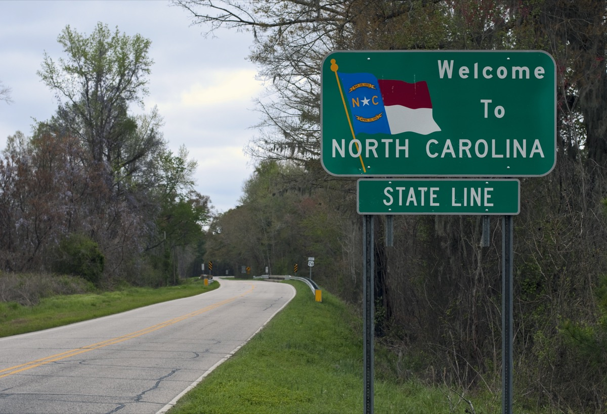 """a green """"Welcome to North Carolina"""" sign off of a highway"""
