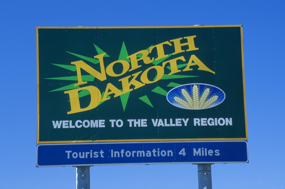 "a green ""North Dakota"" road sign"