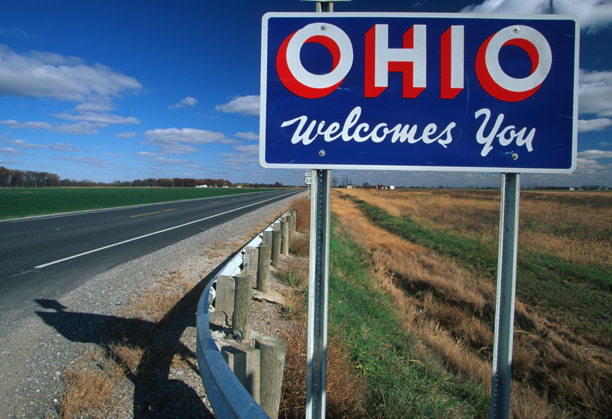 """a blue """"Ohio Welcomes You"""" off of a highway"""