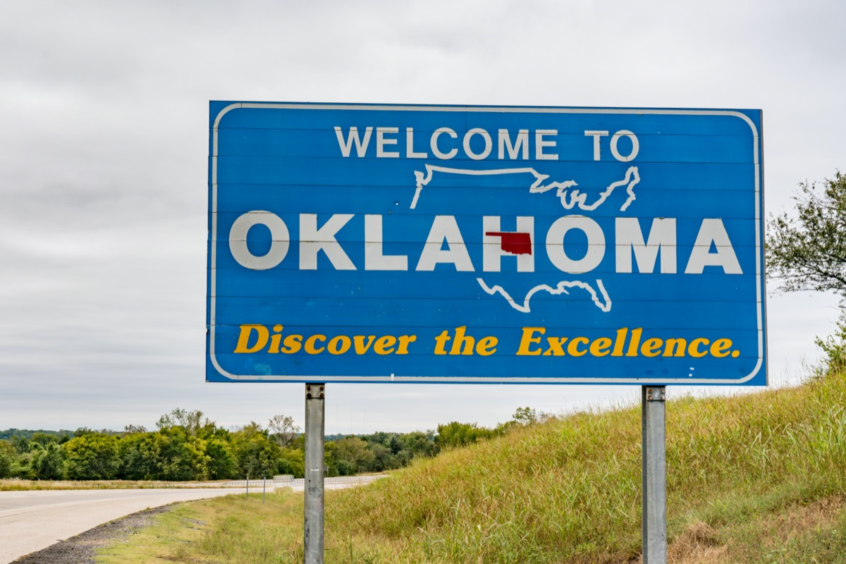 """a blue """"Welcome to Oklahoma"""" sign off of a highway"""