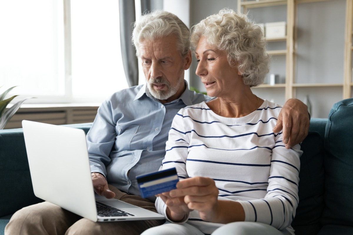 older straight white couple paying bills
