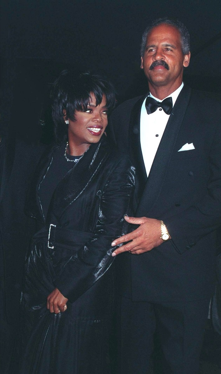 Oprah Winfrey wears a black dress and Stedman Graham wears a black suit at The People's Choice Awards in 1997