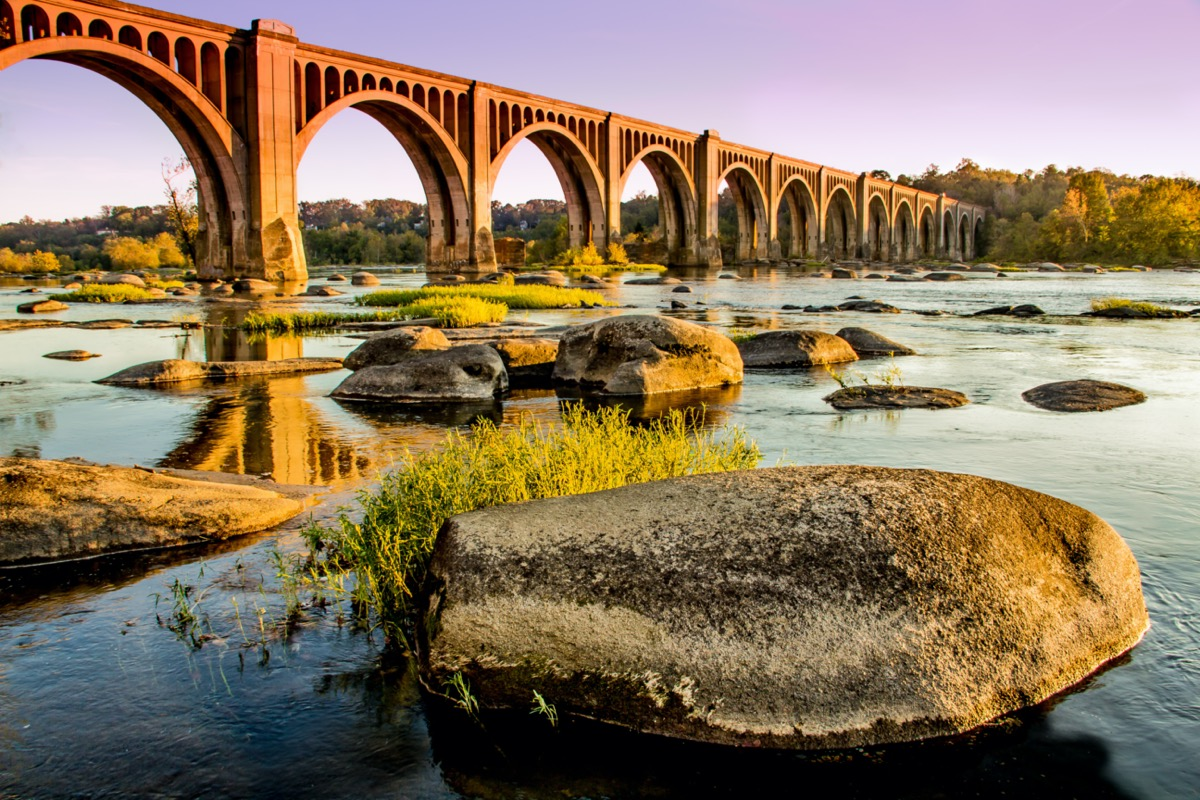 a bridge over and rocks on the James River in Richmond, Virginia