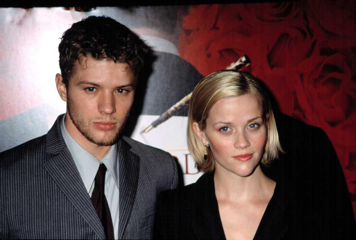 Reese Witherspoon wears a black jacket and Ryan Phillippe wears a grey suit at the premiere of 'Gosford Park' in 2001