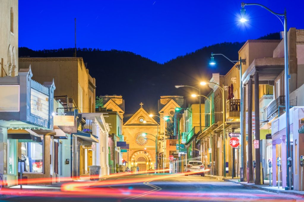 buildings and an empty street in downtown Santa Fe, New Mexico at night