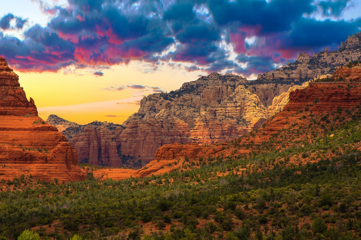 red mountains and green trees at sunset in Sedona, Arizona