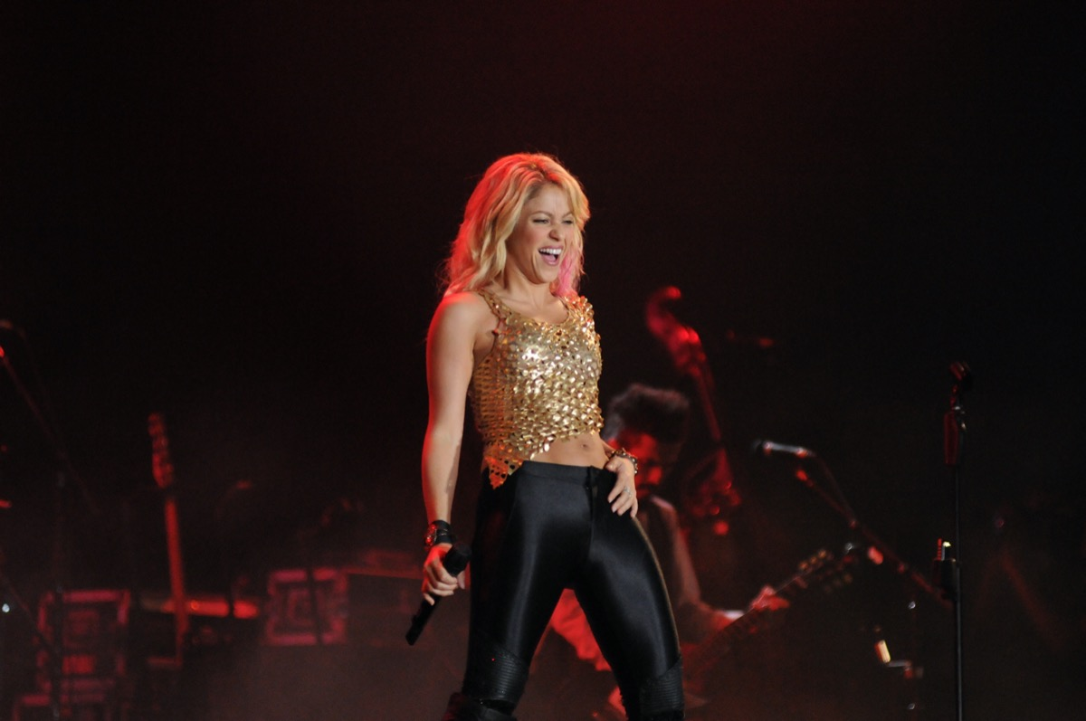 Shakira wears a gold top and leather pants while performing at the Rock in Rio Music Festival in 2019