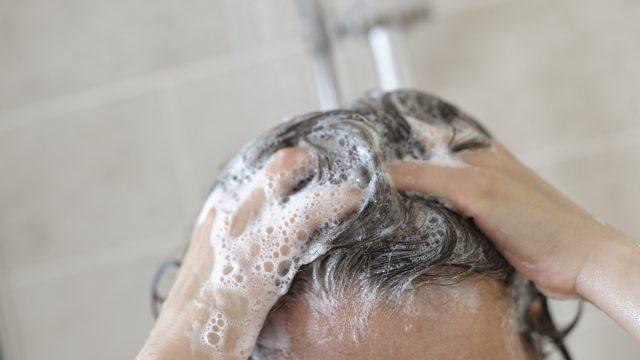 Closeup of a woman washing her hair.