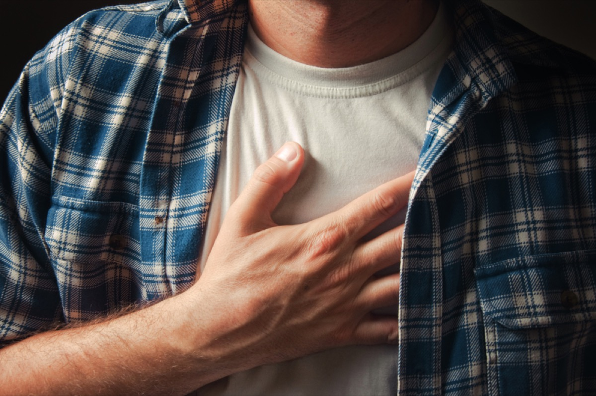 close up of man's hand on chest