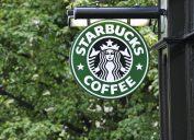 Edinburgh, Scotland - July 19, 2011: A Starbucks Coffee sign outside a Starbucks Coffee outlet on Edinburgh's Royal Mile. Starbucks Corporation is an international coffee and coffeehouse chain based in Seattle, Washington.