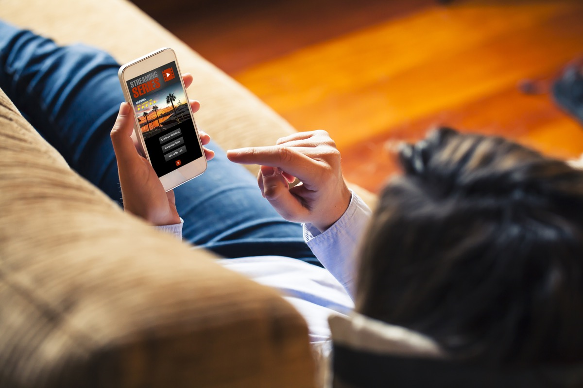 Woman watching streaming service on her phone