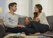 Couple talking on the couch expressing gratitude