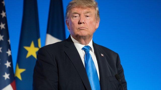 trump staring while standing at podium