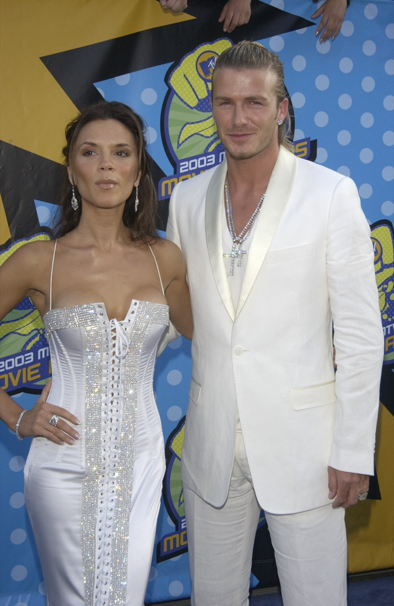 Victoria Adams wears a white dress and David Beckam wears a white suit at the MTV Movie Awards in 2003